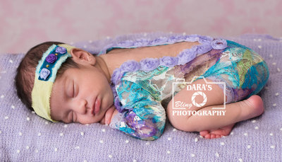 Hollywood Memorial Hospital birth photographer newborn girl on purple blanket