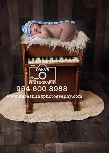 Miami newborn photography baby on piano