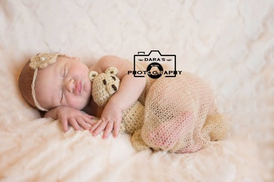 the yoga nest newborn photographer baby girl in nude color wrap with bear