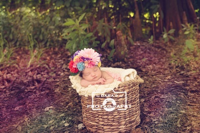 outdoor newborn baby girl forest photography session floral bonnet